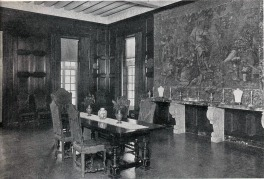 David Adler, Mr/s. Charles A. Stonehill, Glencoe, Illinois, 1911. Dining Room. English walnut paneling with hand-carved walnut table and high back upholstered chairs.