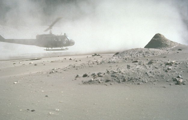 a helicopter stirs up ash while trying to land in the devastated area on August 22nd, 1980. USGSLyn Topinka
