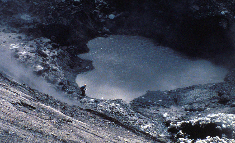 USGS vulcanologist Dave Johnston collects samples from Mount St. Helens crater lake on April 30, 1980