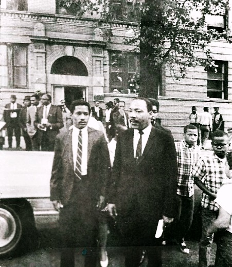 Dr. King exits the tenement apartment at 1550 S. Hamlin on Chicago's West Side where his family stayed in 1966