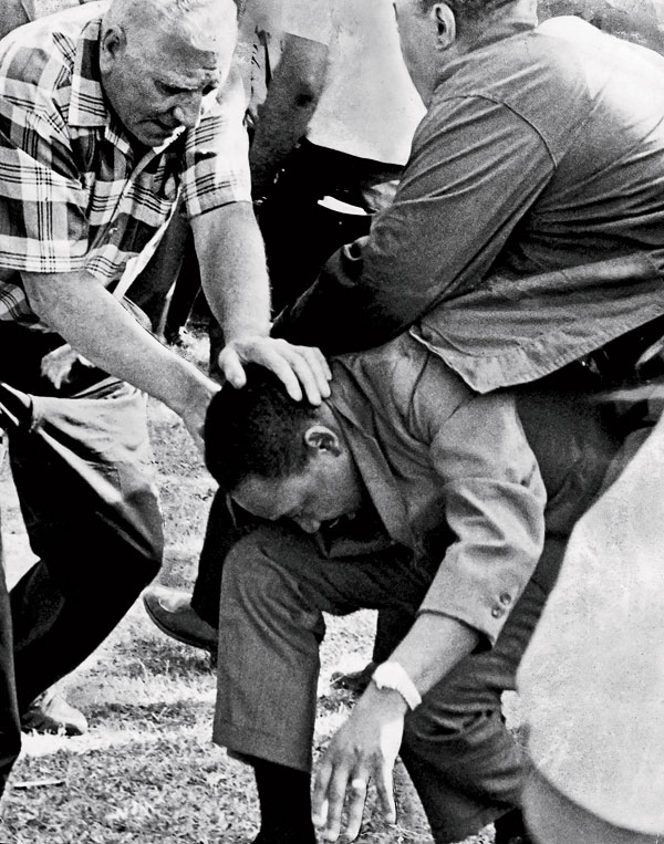 King after being struck by a rock at the August 5 protest. PHOTO CHICAGO TRIBUNE