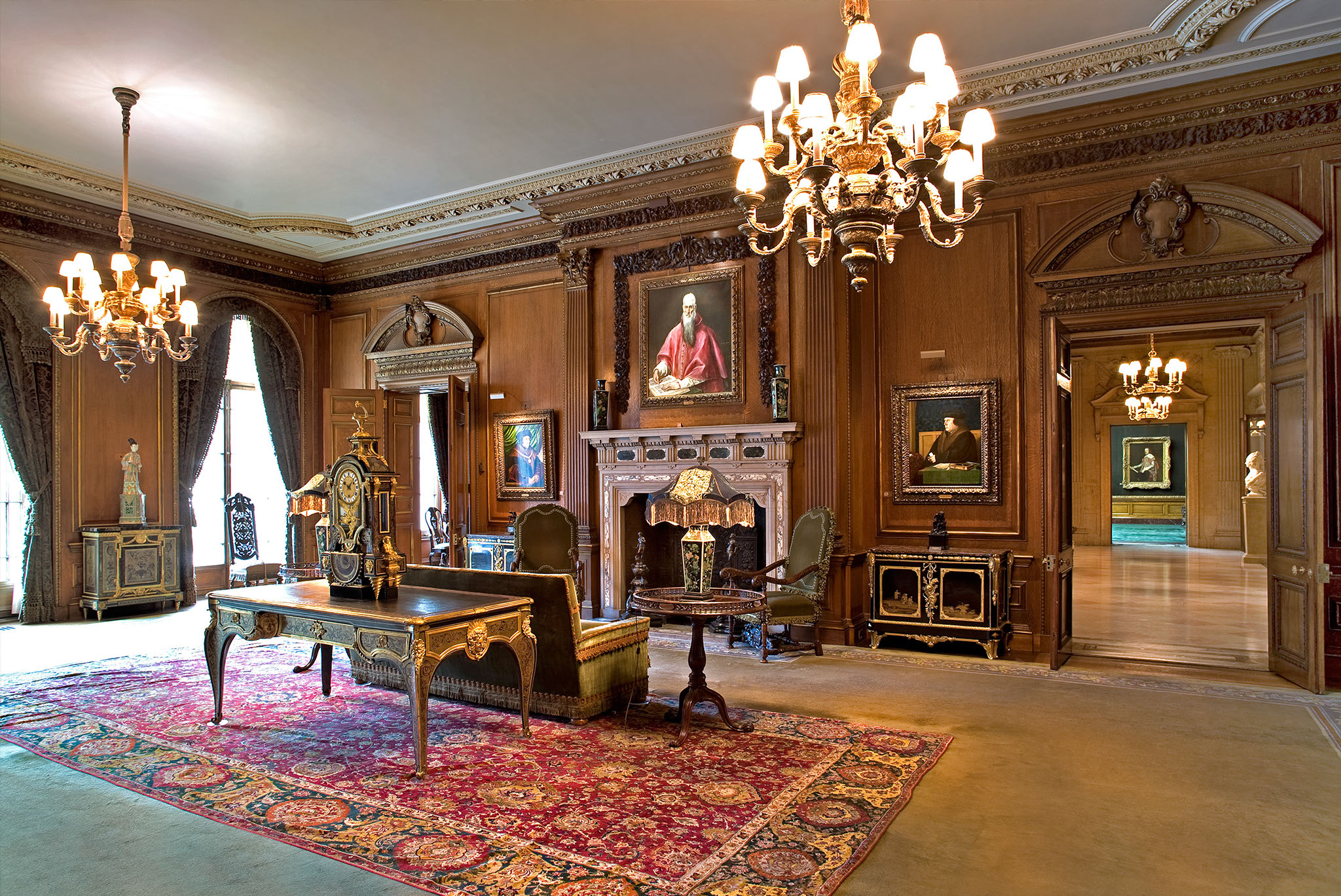 The Living Room of the Frick Collection. Thomas More against Olver Cromwell with El Greco's Saint Jerome in the middle.