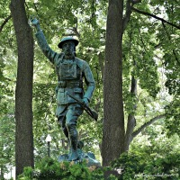 The Doughboy statue (1921) by sculptor John Paulding in Wheaton, Illinois, memorializes veterans of World War One.