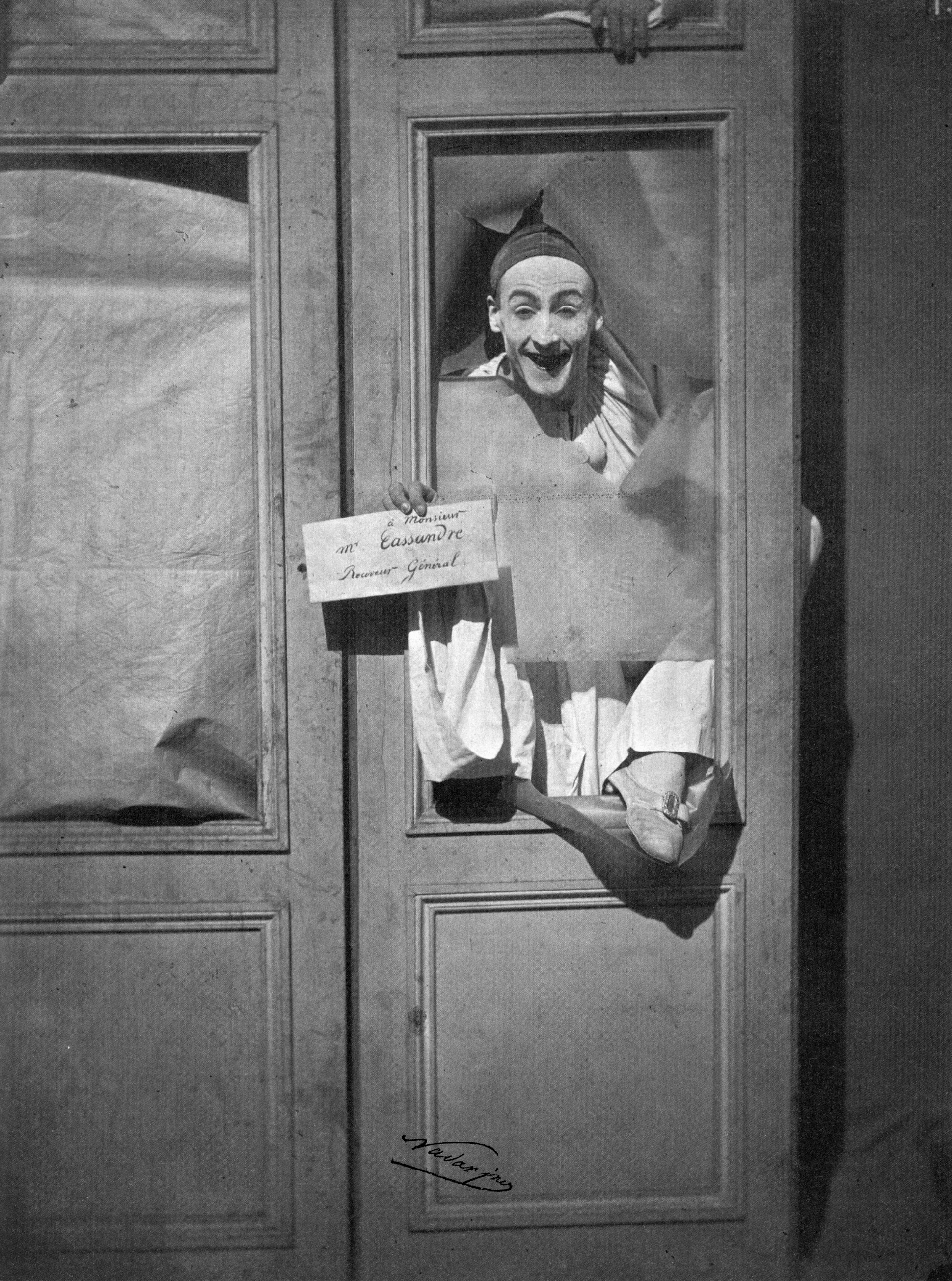 pierrot jumping through a window